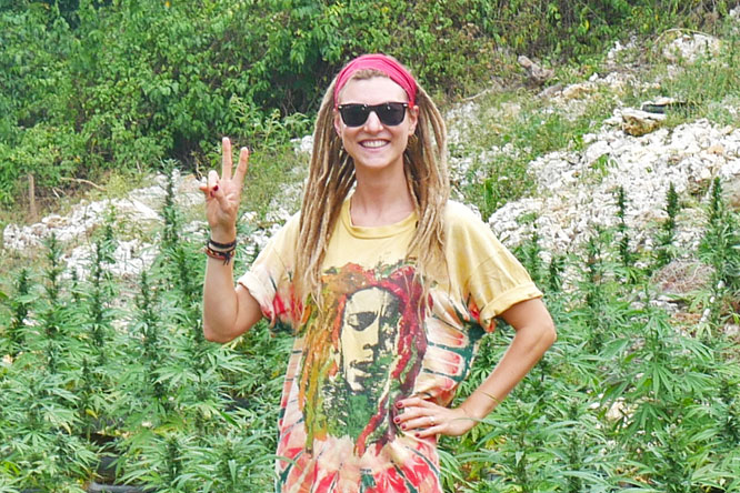 Rasta girl in ganja field near Negril, Jamaica