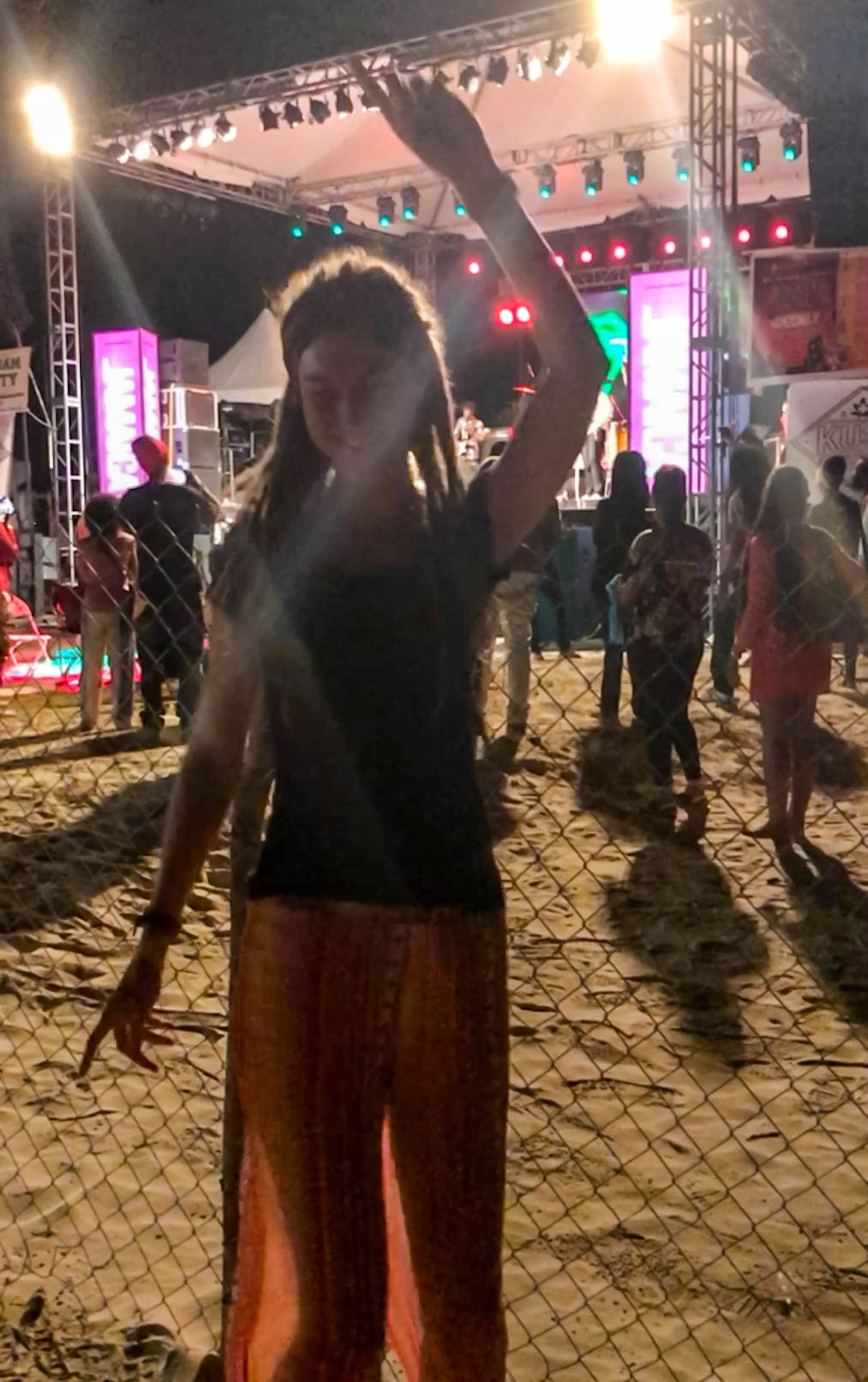 Girl dancing at Rastafari Rootzfest Concert, Seven Mile Beach, Negril, Jamaica