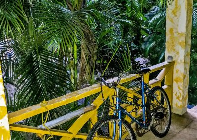 Blue bicycle on porch in hotel in West End, Jamaica