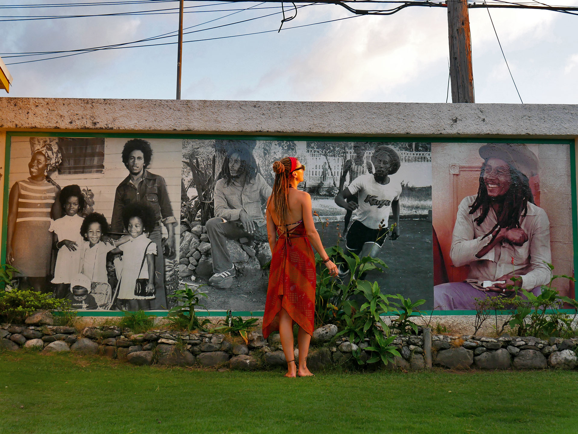 Rasta girl in front of picture wall at Bob Marley Museum in Kingston, Jamaica