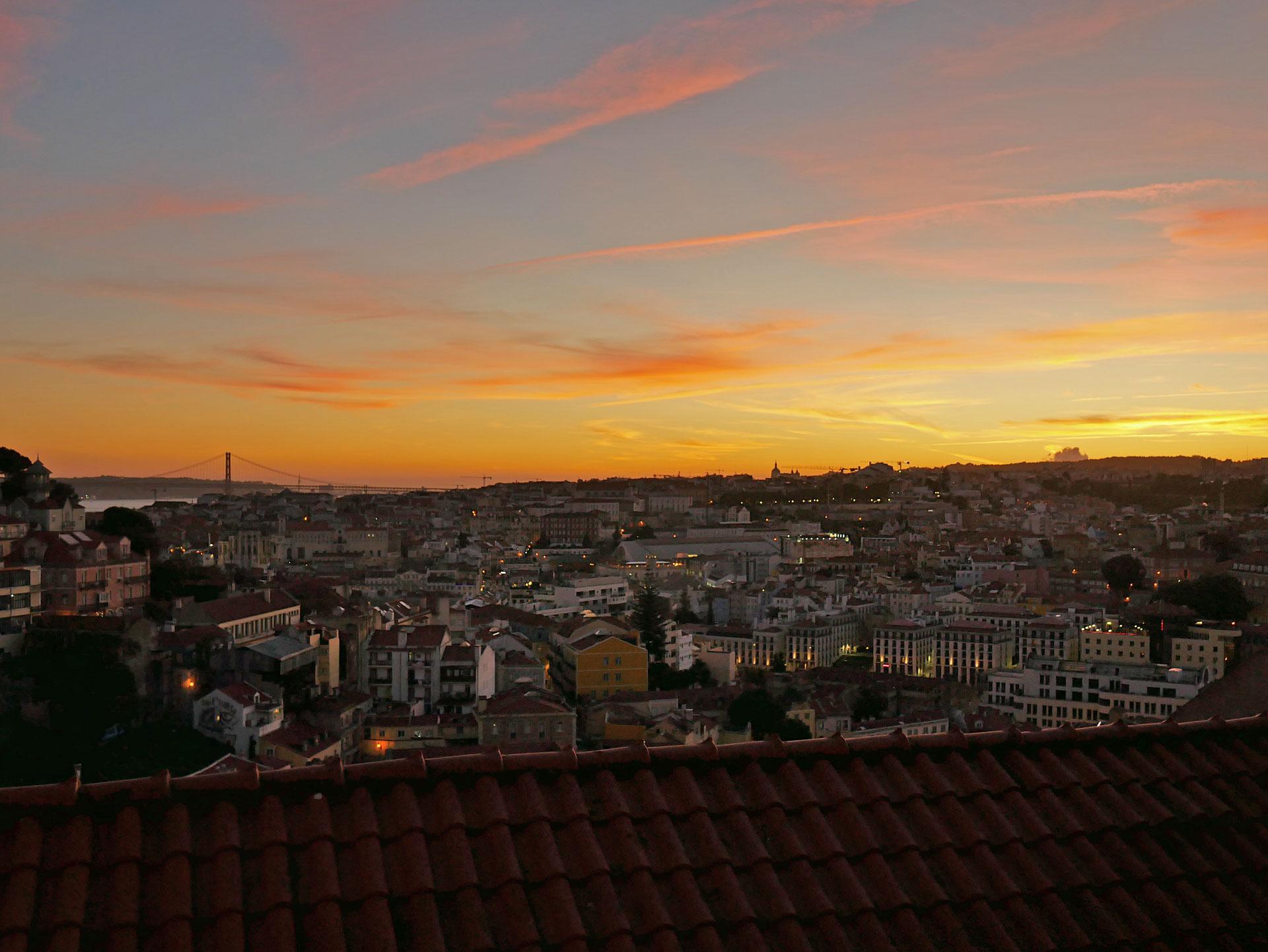 Sunset sky from Sophia de Mello Breyner Andresen viewpoint in Lisbon, Portugal