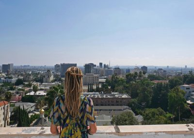 Rasta girl overlooking Hollywood Skyline in Los Angeles, CA