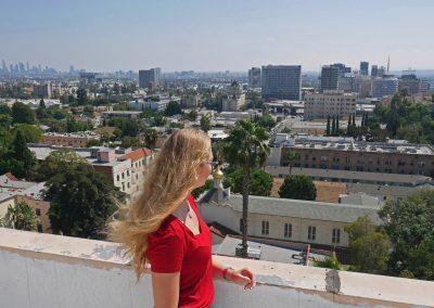 Travel girl overlooking Hollywood Skyline in LA, CA