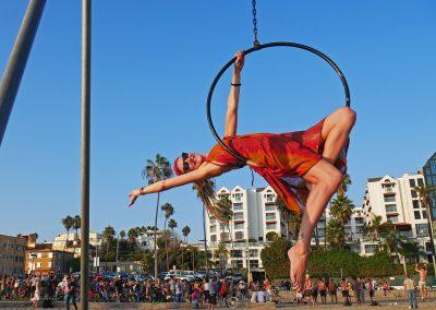 Dreadlock girl in hoop at original muscle beach in Santa Monica, CA