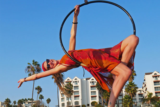 Rasta girl in hoop at original muscle beach in Santa Monica, CA