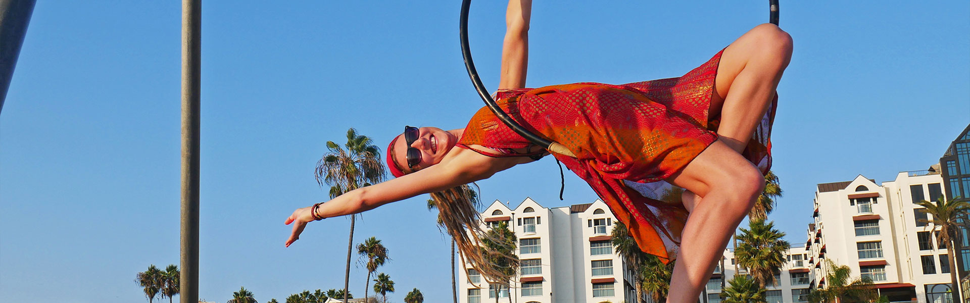 Rasta girl in hoop at original muscle beach in Santa Monica, CA