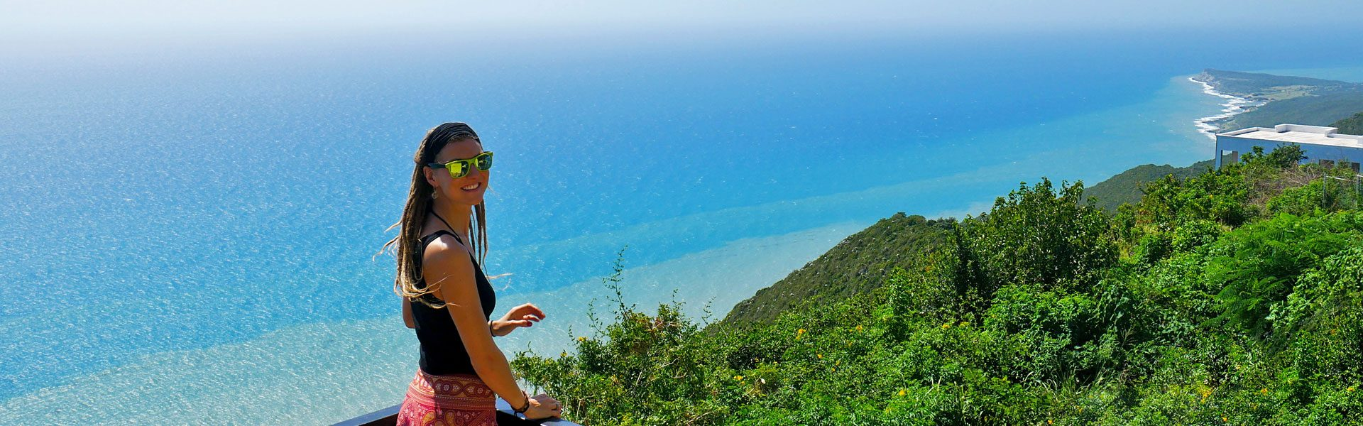 Rasta girl at Lovers Leap overlooking ocean in Southfield, Jamaica