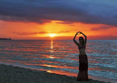 Rasta girl during sunset at Seven Mile Beach, Negril, Jamaica