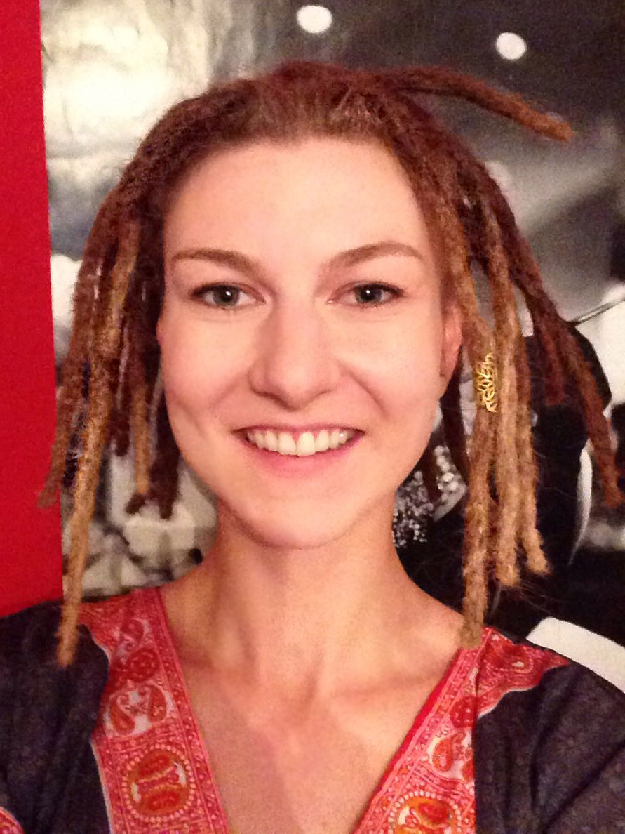 Blonde girl with short dreadlocks shortly after being locked