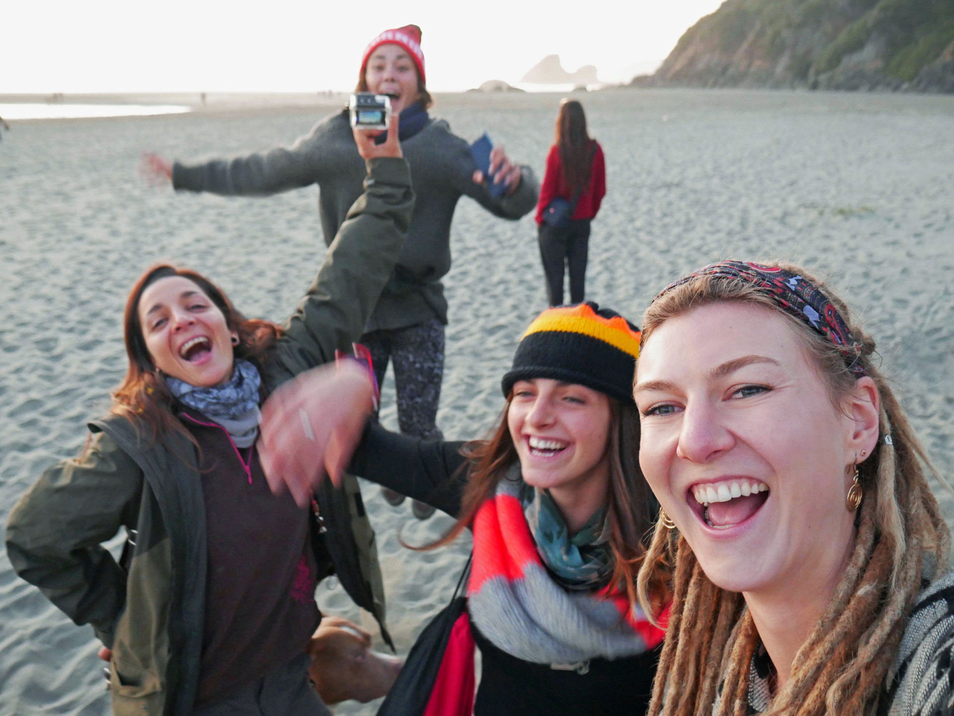 Friends having good time at Moonstone Beach in Northern California