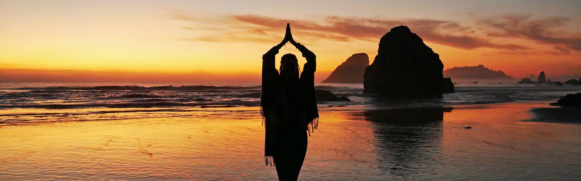 Rasta girl during sunset at Moonstone Beach in Northern California