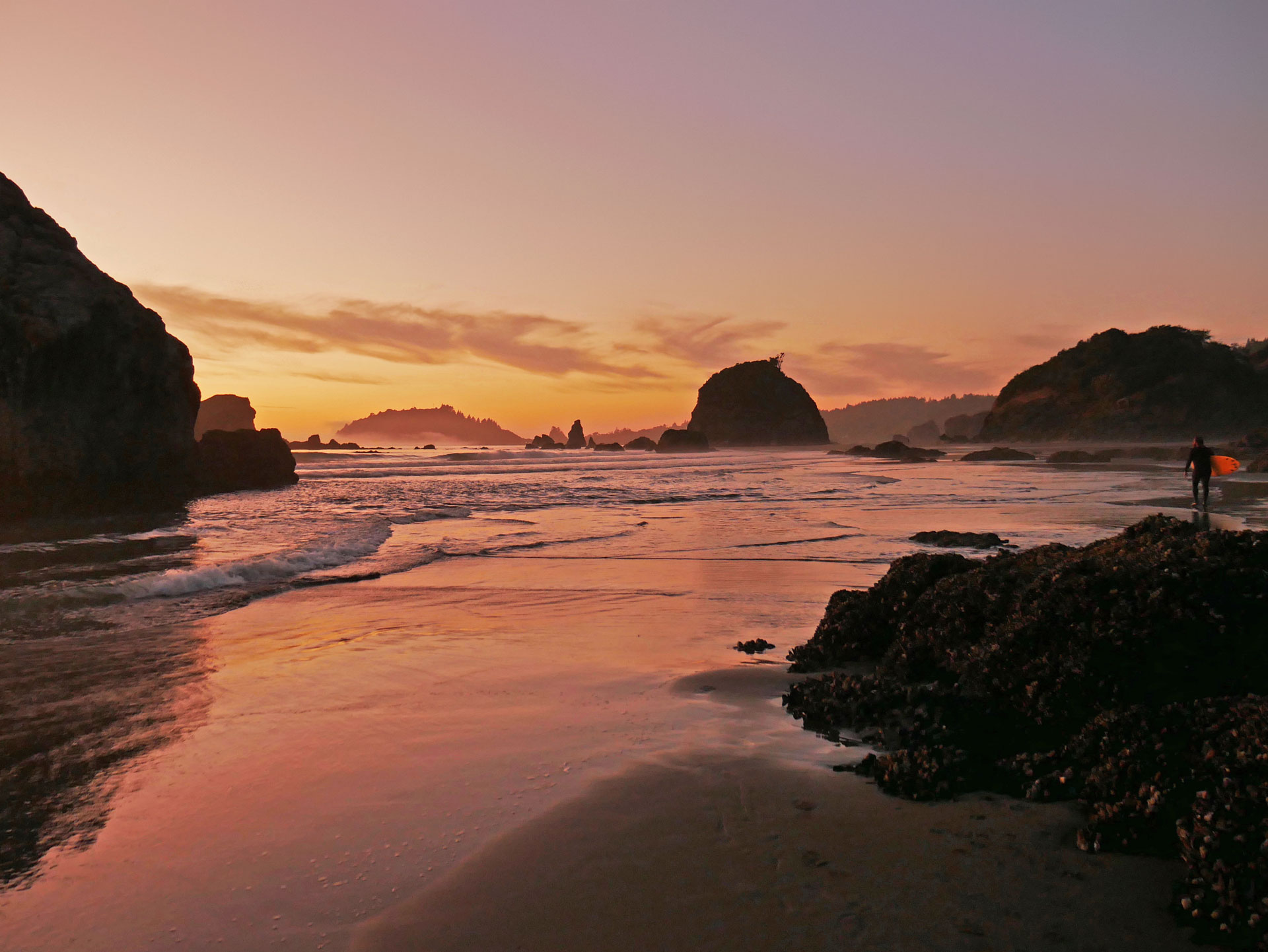 Surfer during sunset at Moonstone Beach in Northern California