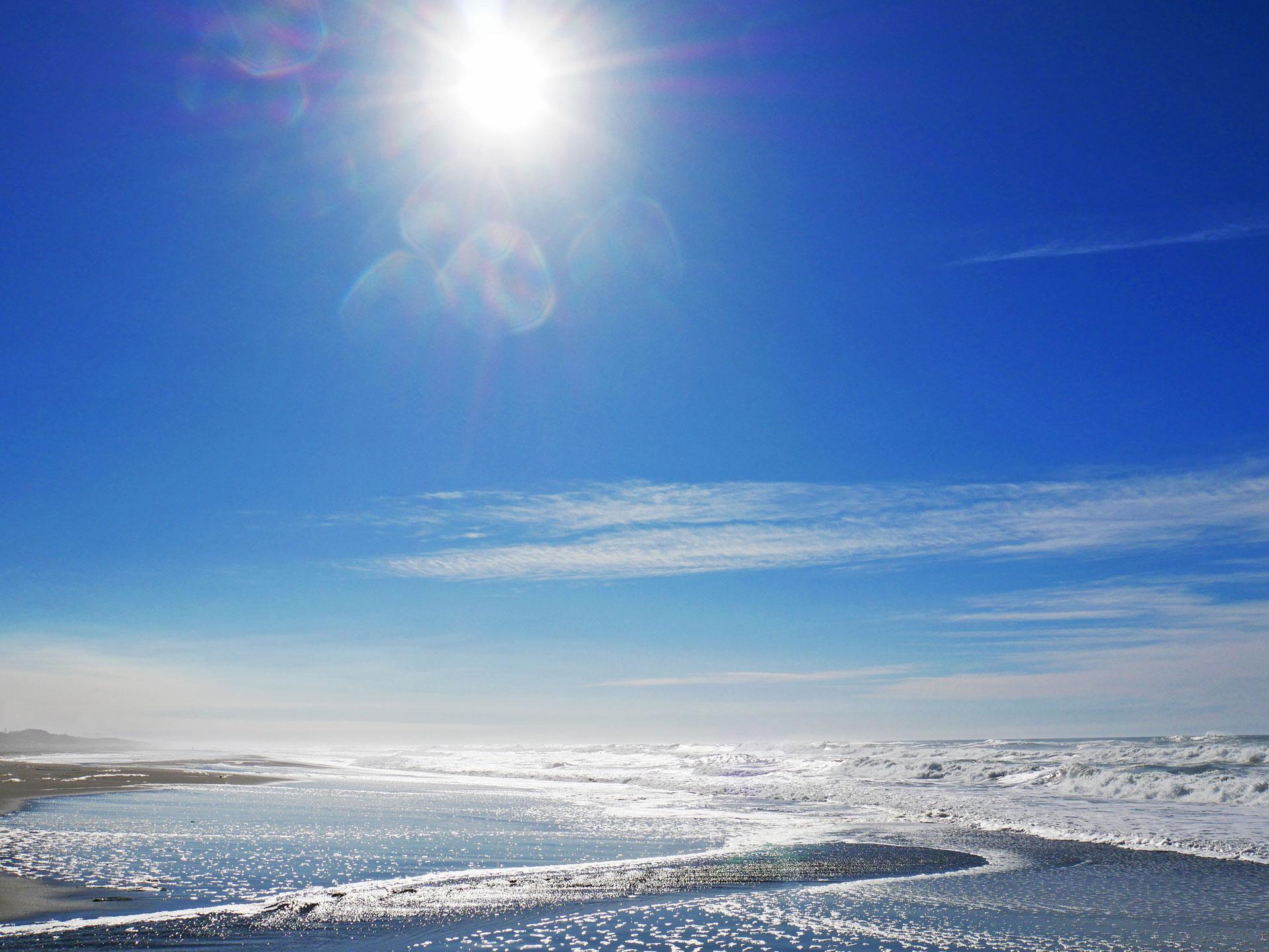 Sun shining over ocean in Samoa, Humboldt County, CA