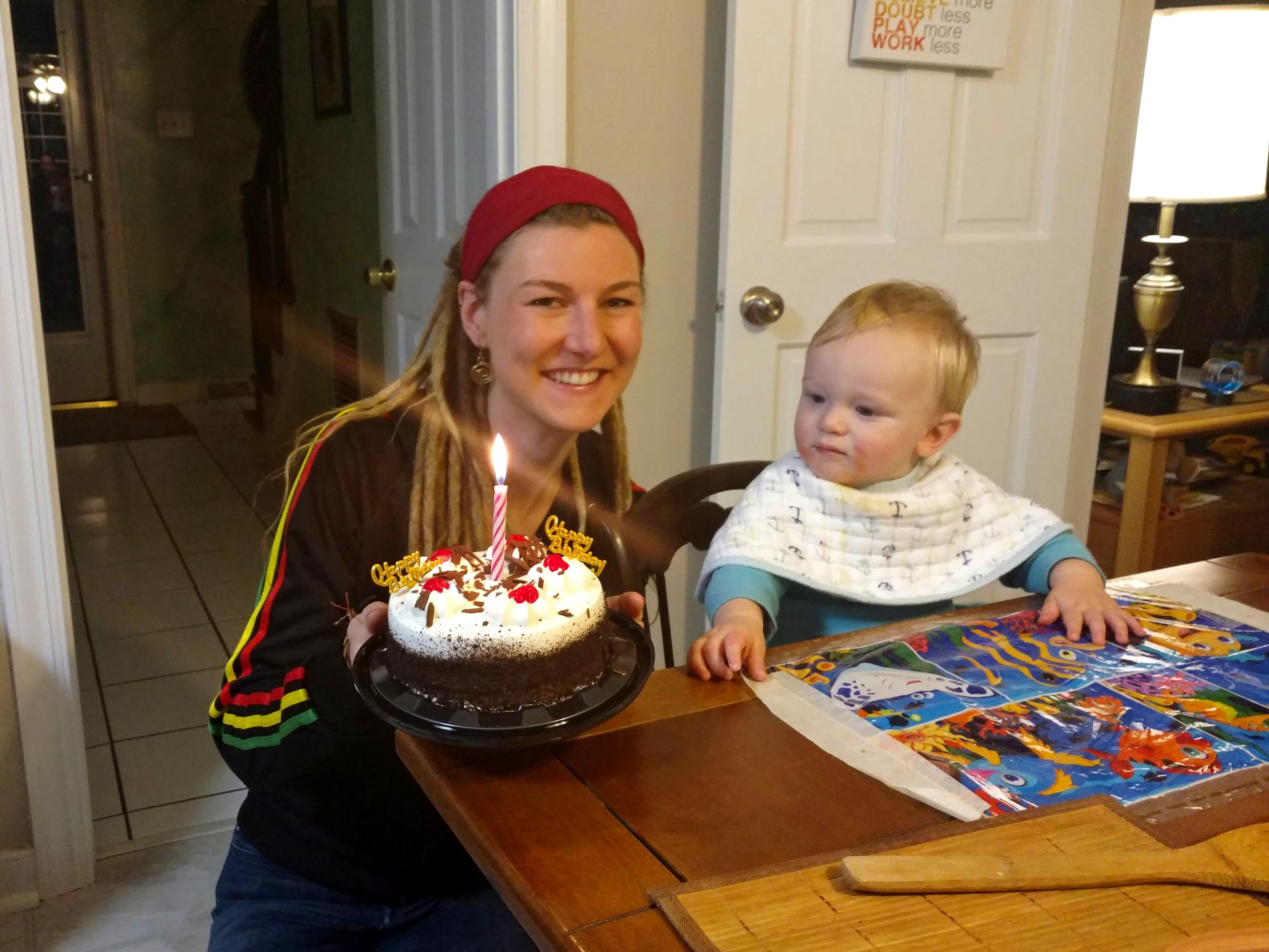 Rasta girl with birthday cake and baby looking at it in Richmond, VA