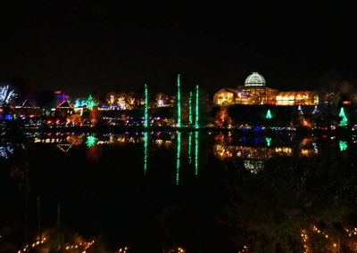Light reflections in lake of Lewis Ginter Botanical Garden at GardenFest of Lights in Richmond, VA