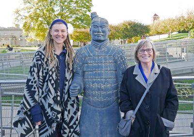 Rasta girl and American mom with statue of Terracotta Army at VMFA
