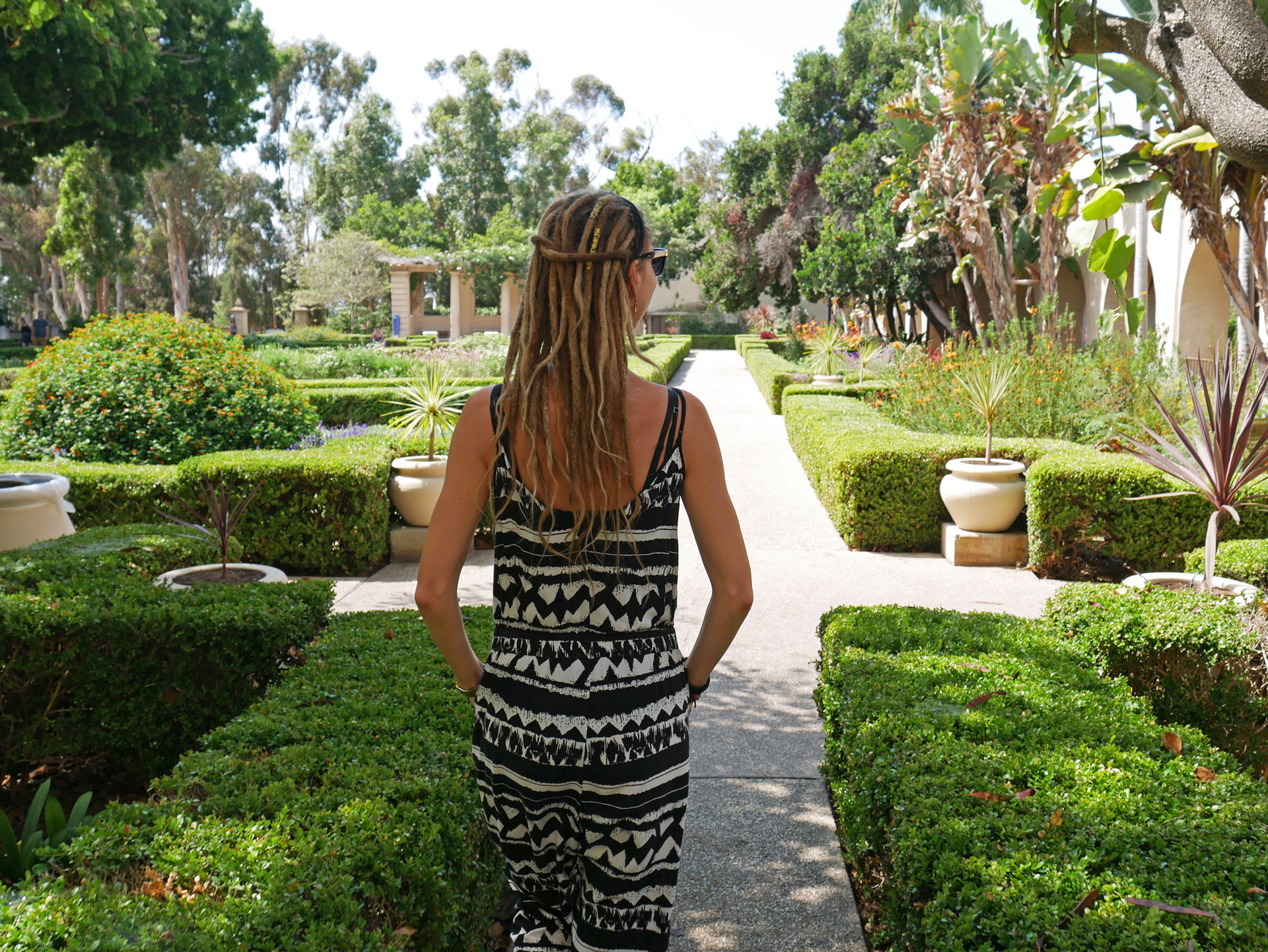 Rasta girl walking around Balboa Park in San Diego, CA