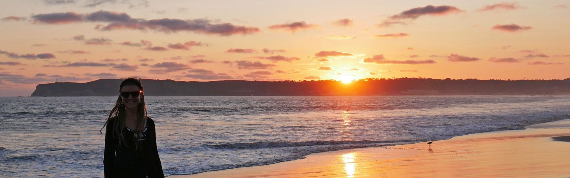 Rasta girl during sunset at Coronado Beach in San Diego, CA