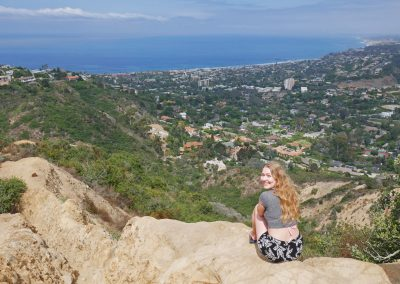 Girl overlooking La Jolla in San Diego, CA, and the West Coast from mountain viewpoint