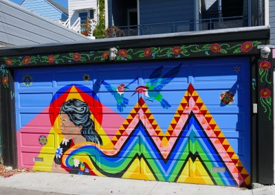 Garage painted with woman, flowers and birds in Balmy Alley in San Francisco, CA