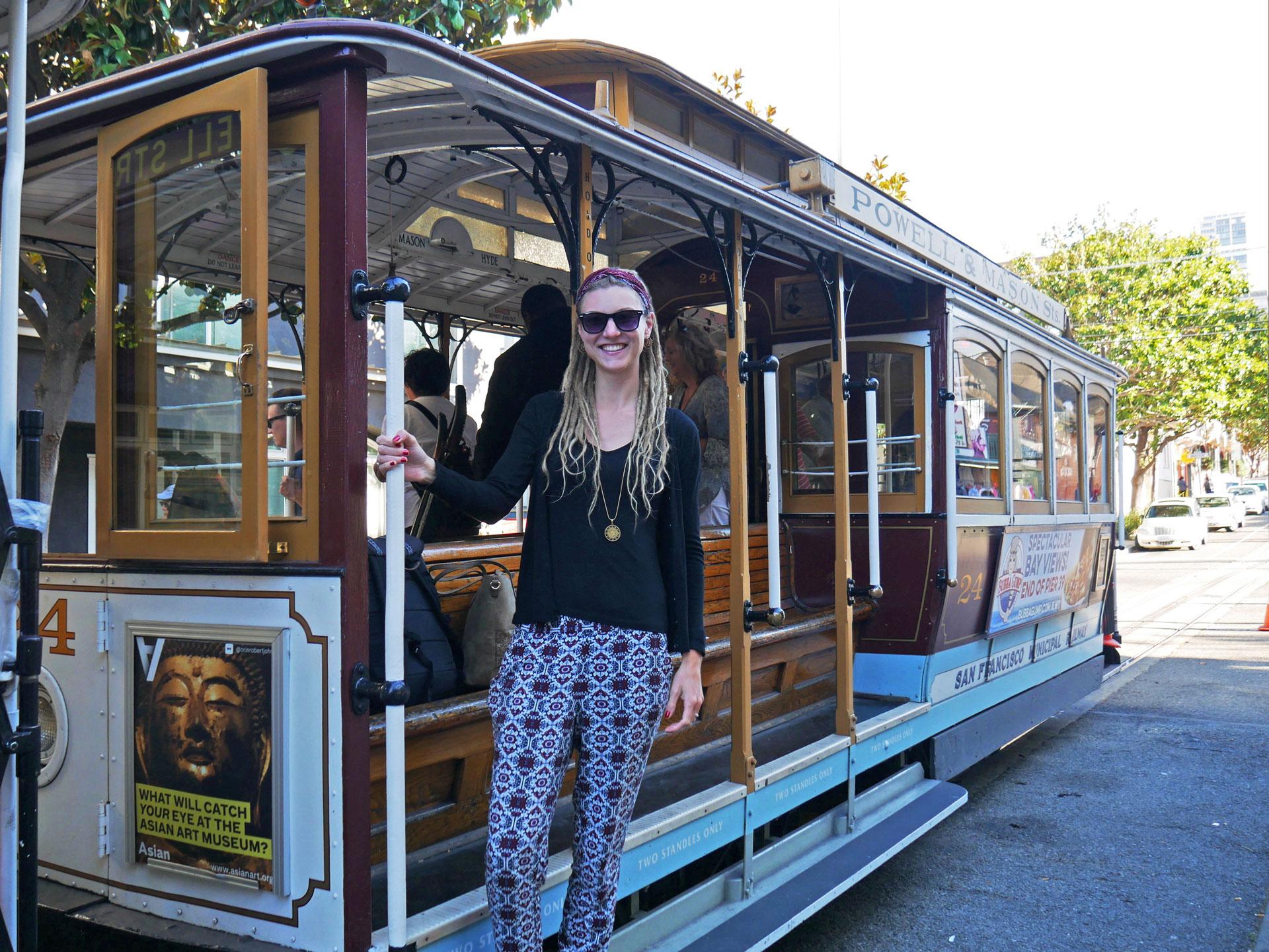 Rasta girl on San Francisco Cable Car at Mason Street, CA