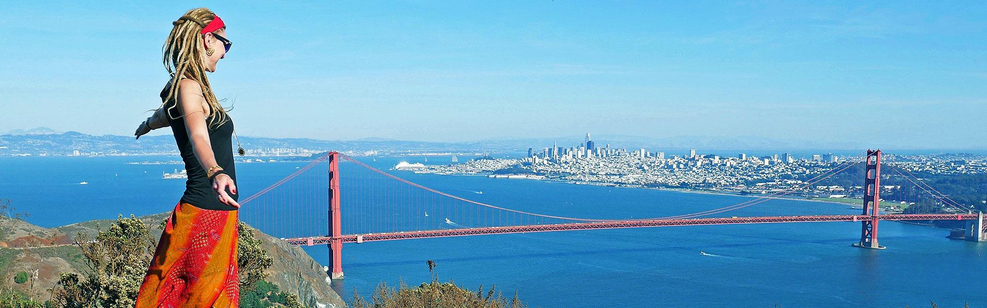 Rasta girl at Marin Headlands overlooking Golden Gate Bridge, city and San Francisco Bay