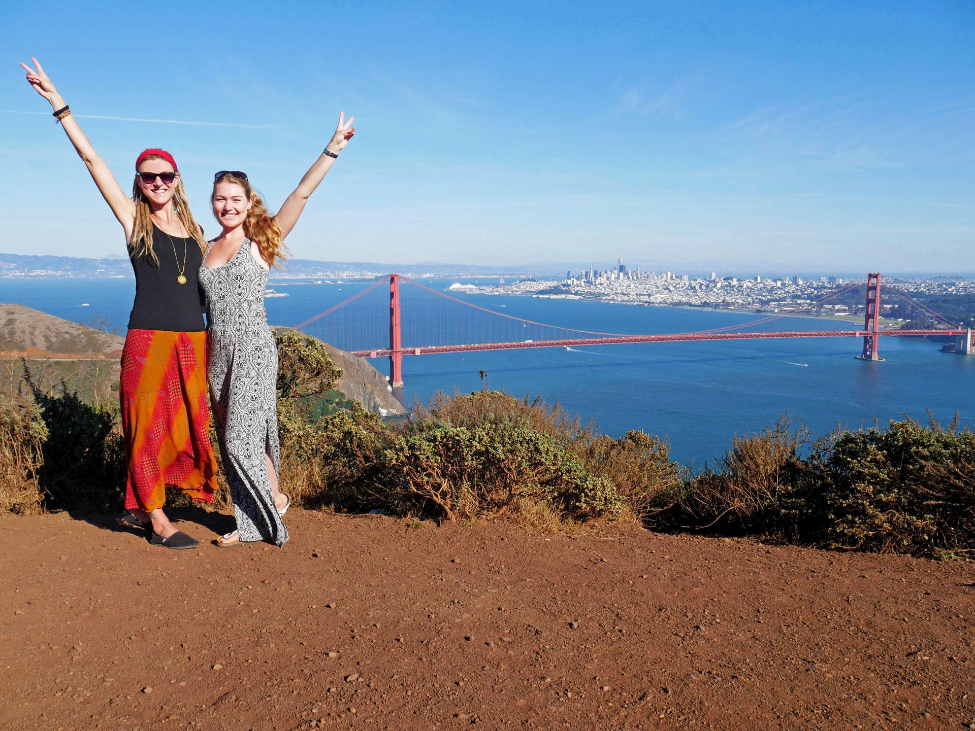 Sisters at Marin Headlands overlooking Golden Gate Bridge, city and San Francisco Bay