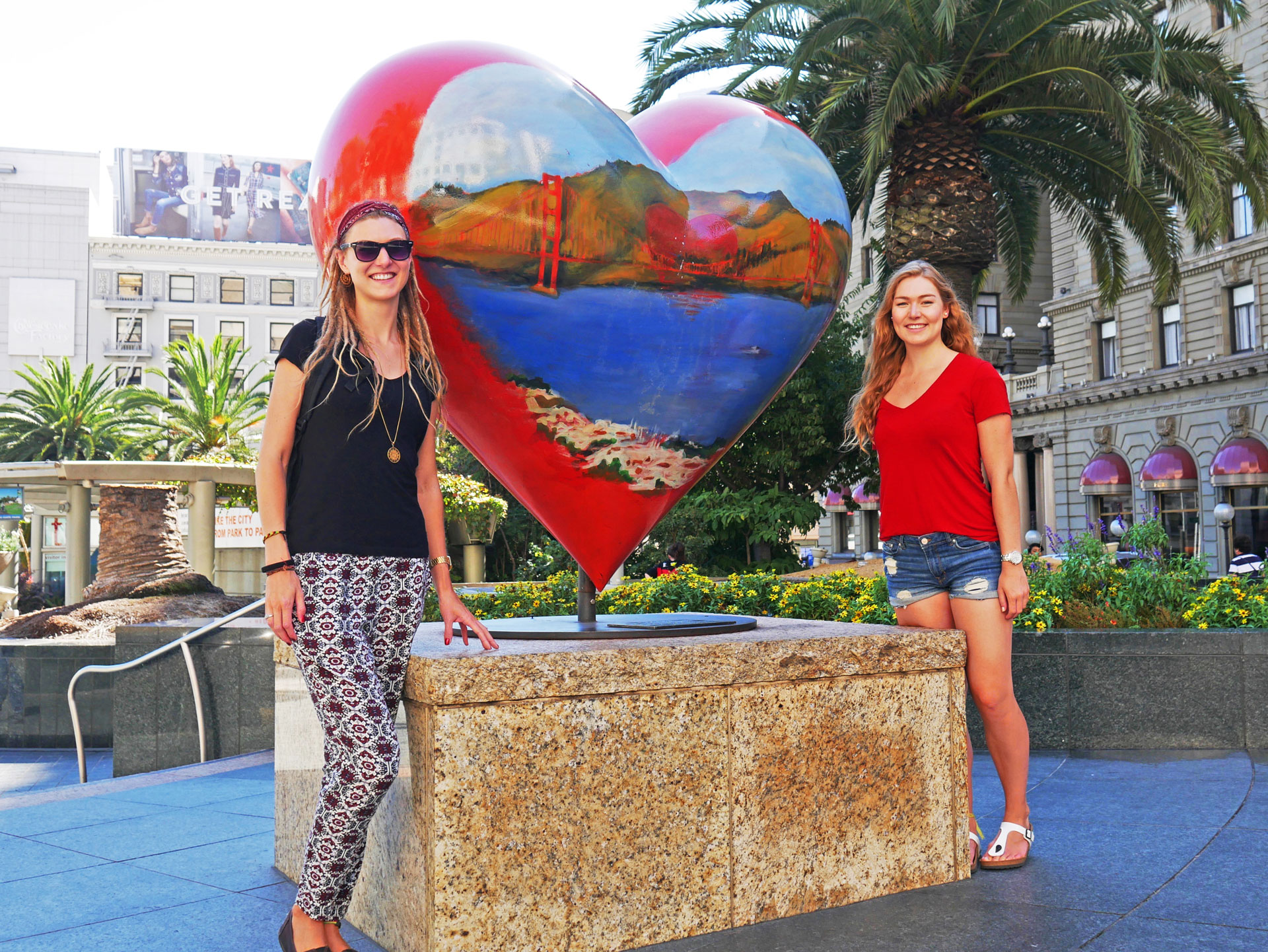 Sisters next to Bennett's heart sculpture at Union Square in San Fran, CA