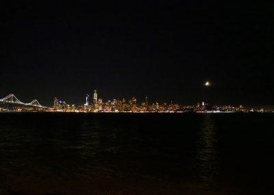 Skyline of San Fran and Bay Bridge at night from Treasure Island, California