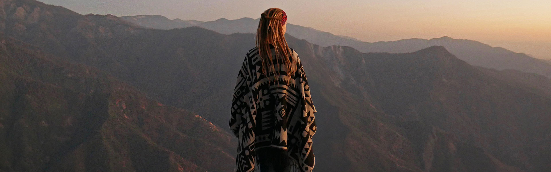 Rasta girl watching sunset from Moro Rock in Sequoia National Park