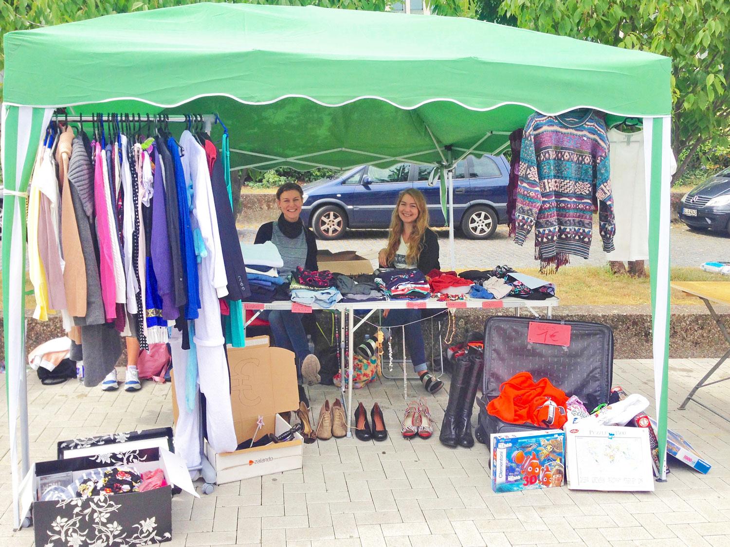 Sisters at flea market on bank of Rhine in Cologne, Germany