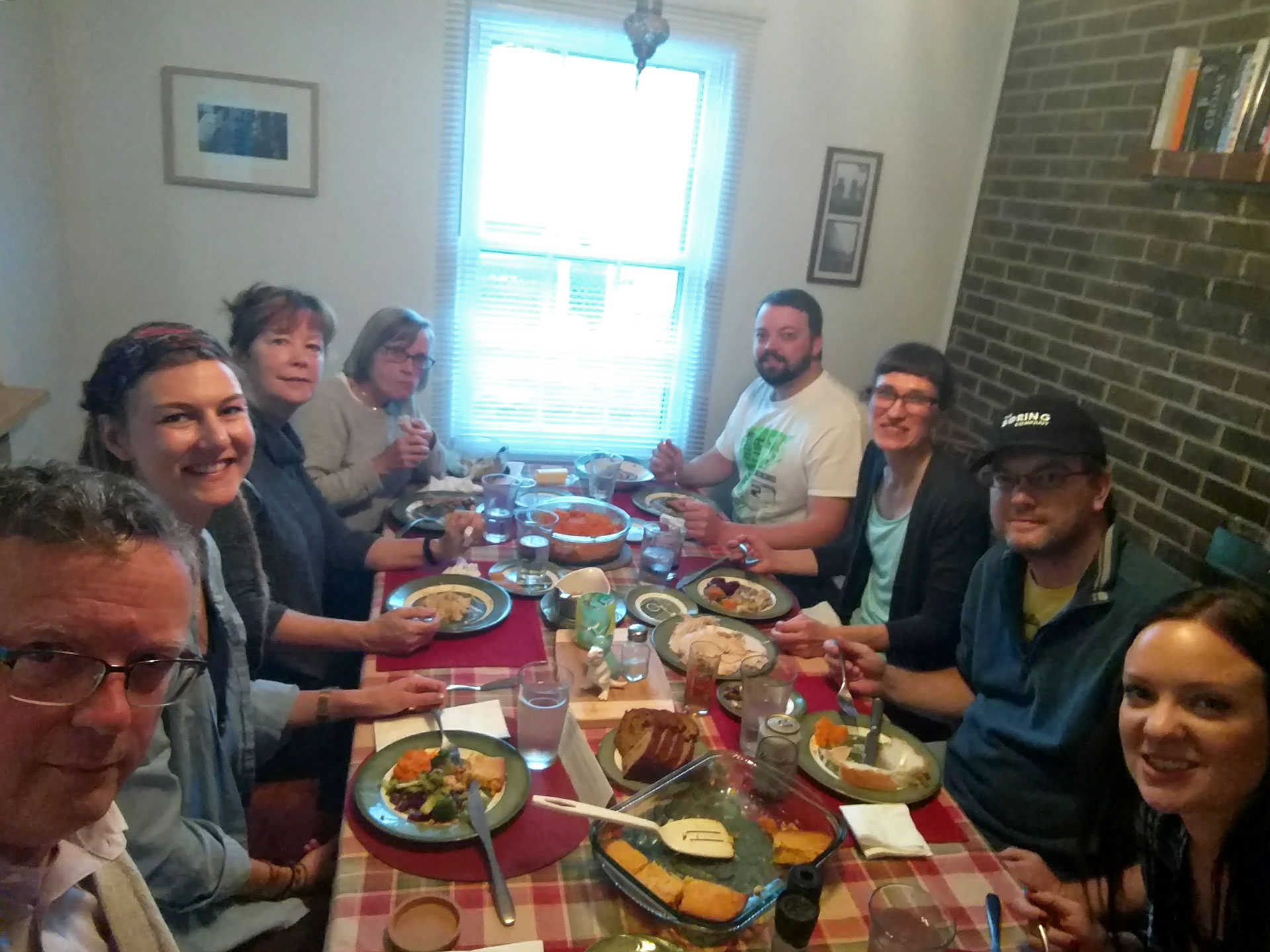 Thanksgiving table with food and family eating in Winchester, VA
