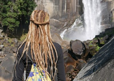 Rasta girl in front of Vernal Falls in Yosemite National Park, California, USA