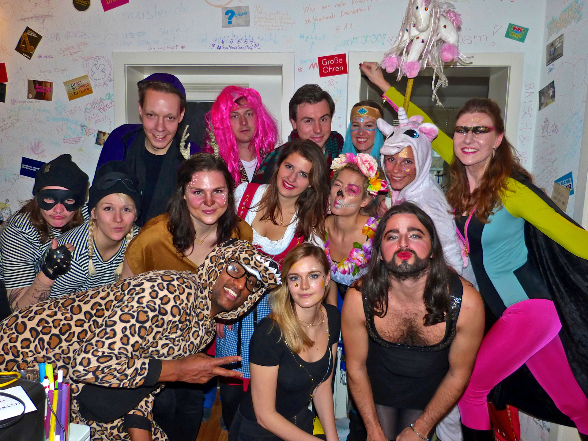 Friends and couchsurfers in different costumes celebrating carnival in Cologne, Germany