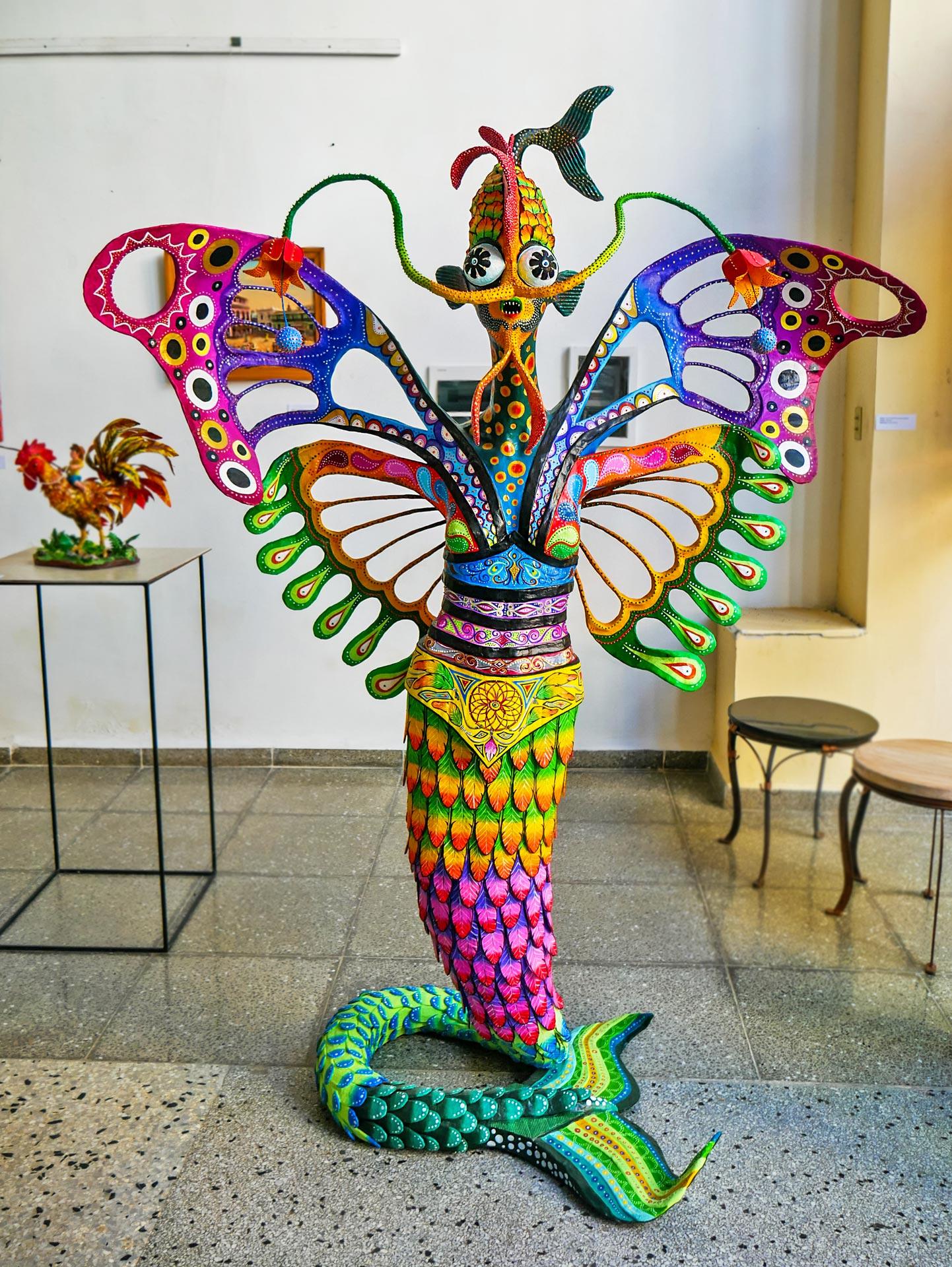 Colorful art sculpture made of papier-mâché in Galeria Manos in Havana, Cuba