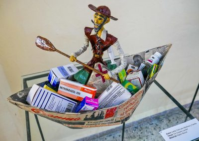 Papier-mâché work of art of a Quichotte sitting in a boat filled with drugs in Galeria Manos in Havana, Cuba