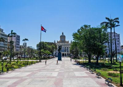 Plaza 13 de Marzo with statue, flag and in background Museum of the Revolution in Havana, Cuba