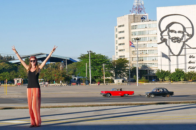 Dreadlock girl at Plaza de la Revolucion in Havana, Cuba, with Che Guevara and Camilo Cienfuegos in background