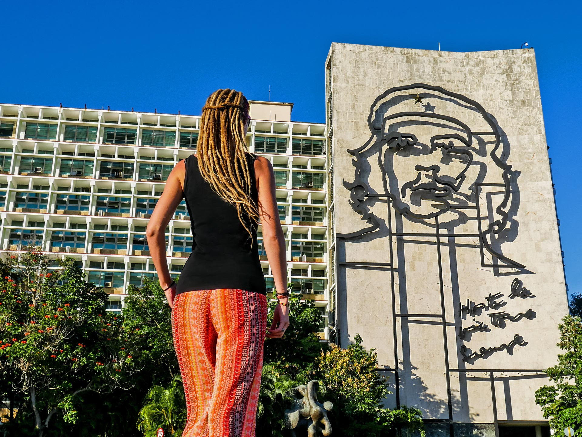 Rasta girl at Plaza de la Revolucion in Havana, Cuba, looking at Che Guevara memorial
