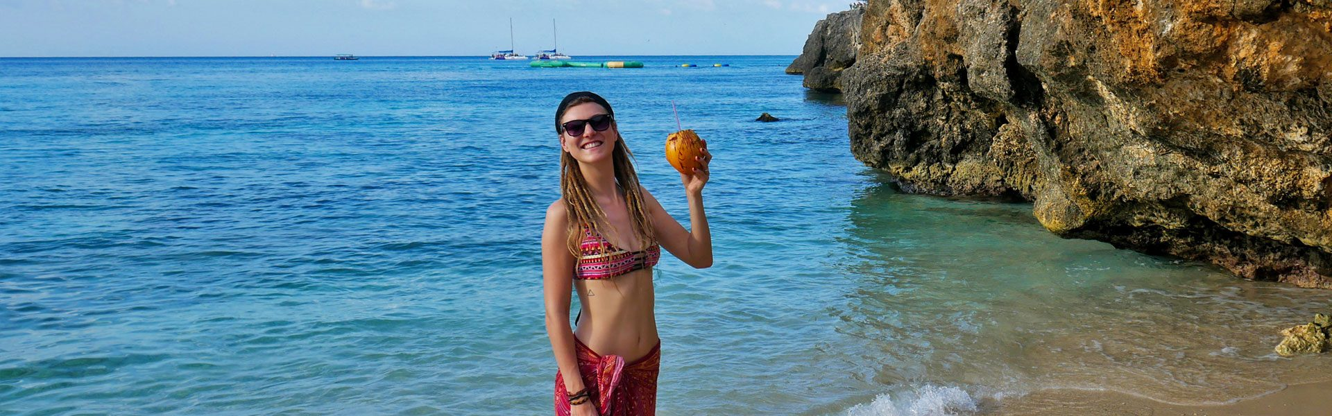 Rasta girl with coconut at beach in Montego Bay, Jamaica