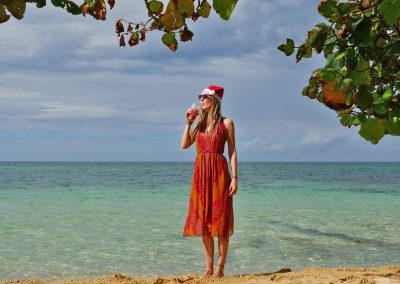 Christmas rasta girl drinking Smoothie at Canoe Beach in West End, Jamaica