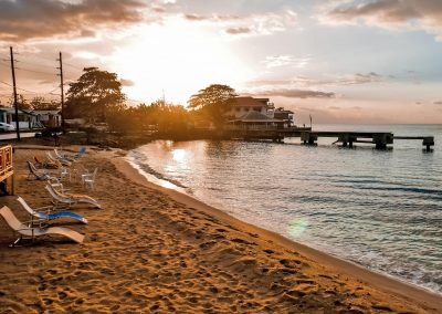 At the Canoe Bar overlooking beach during sunset in West End, Jamaica
