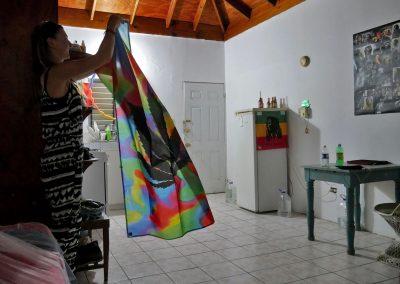 Rasta girl packing her belongings in home in West End, Jamaica