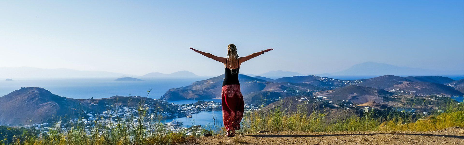 Dreadlock girl on Patmos overlooking ocean and islands