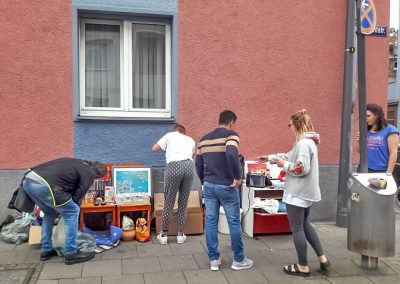 People looking at free household goods on street in Cologne, Germany