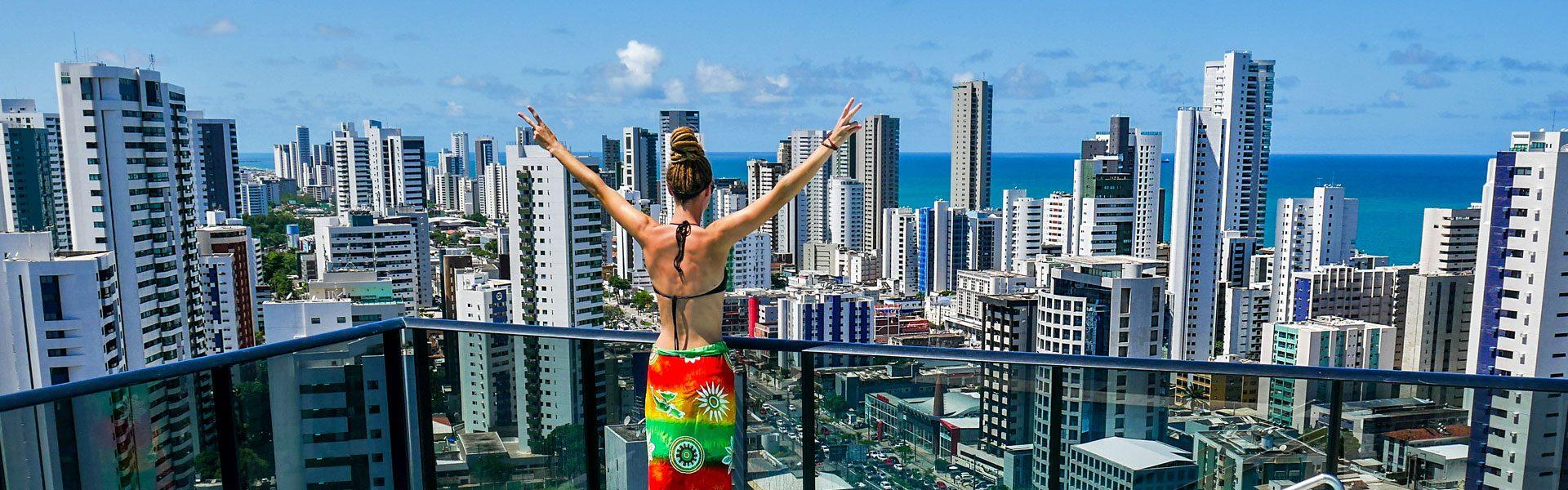 Rasta girl overlooking Boa Viagem and ocean in Recife, Brazil