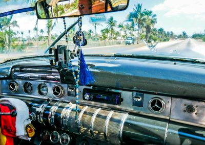 Dashboard of a classic Buick car and street view of Varadero, Cuba