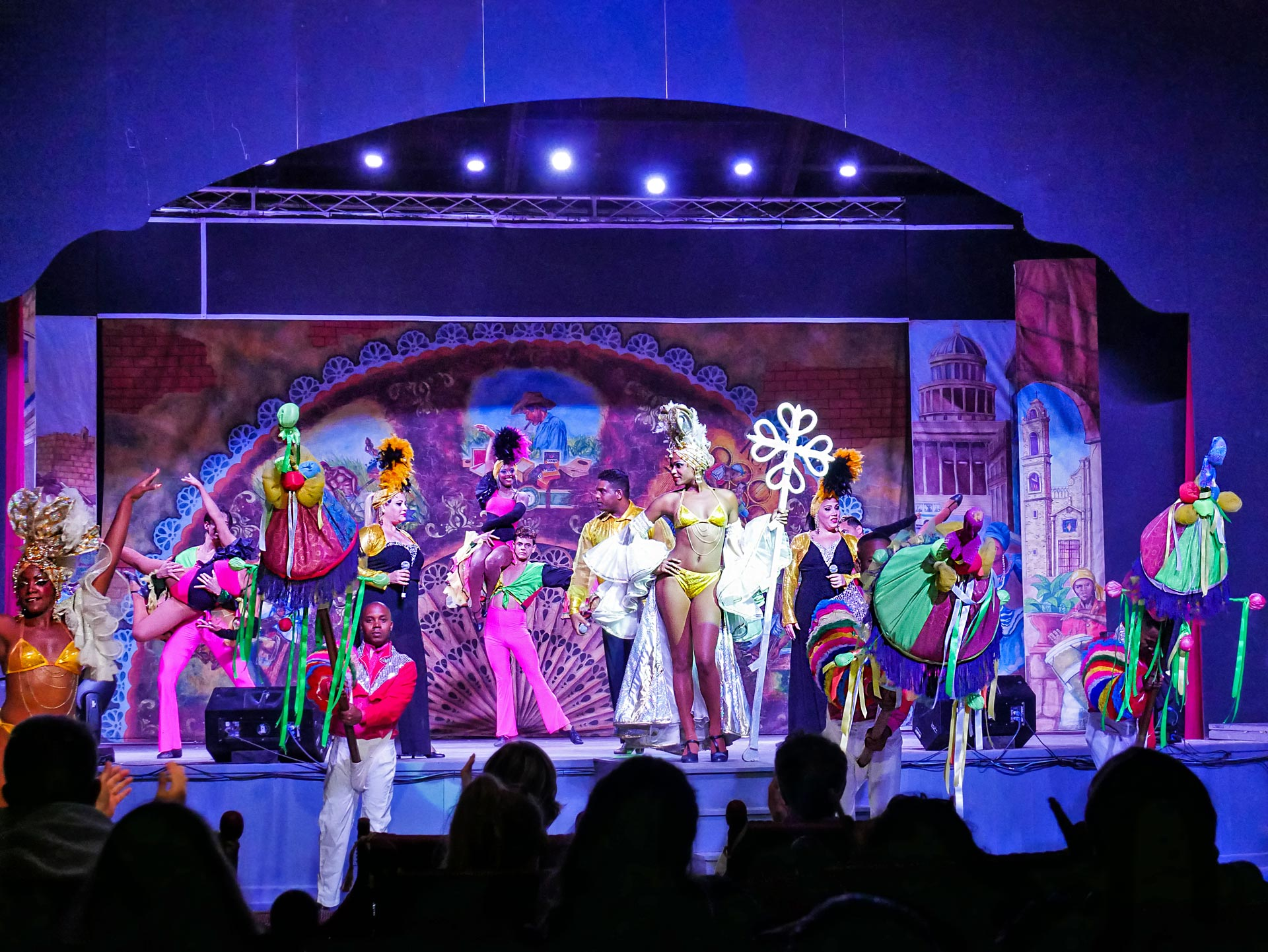 Singers and dancers in colorful outfits during hotel entertainment show in Varadero, Cuba