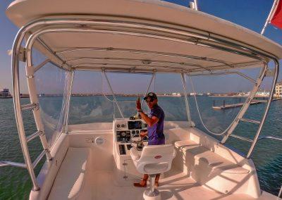 Captain waving while steering scuba dive boat in Varadero, Cuba