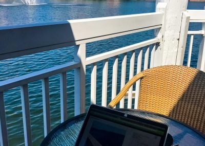 Work setup with laptop and hotel lake in background in Orlando, Florida